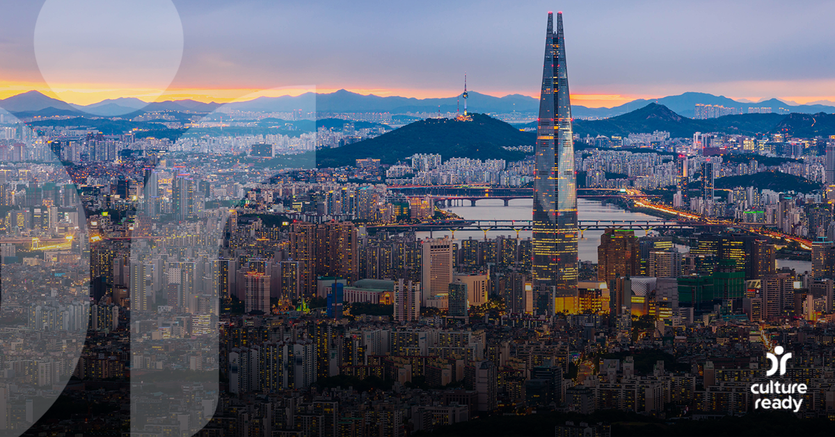 A cityscape of Seoul, South Korea, at dawn with mountains in the background