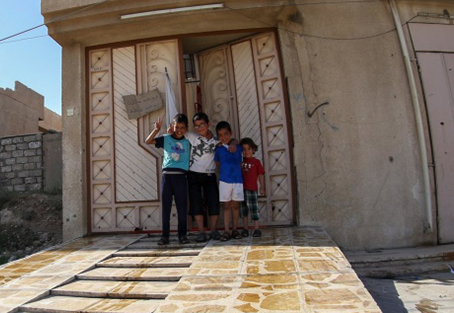 Four kids in a doorway