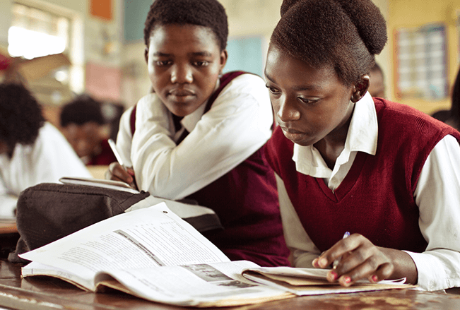 South African girls studying in a classroom.