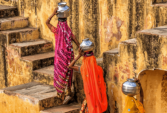 Three Indian women carrying water on their head from near Jaipur.