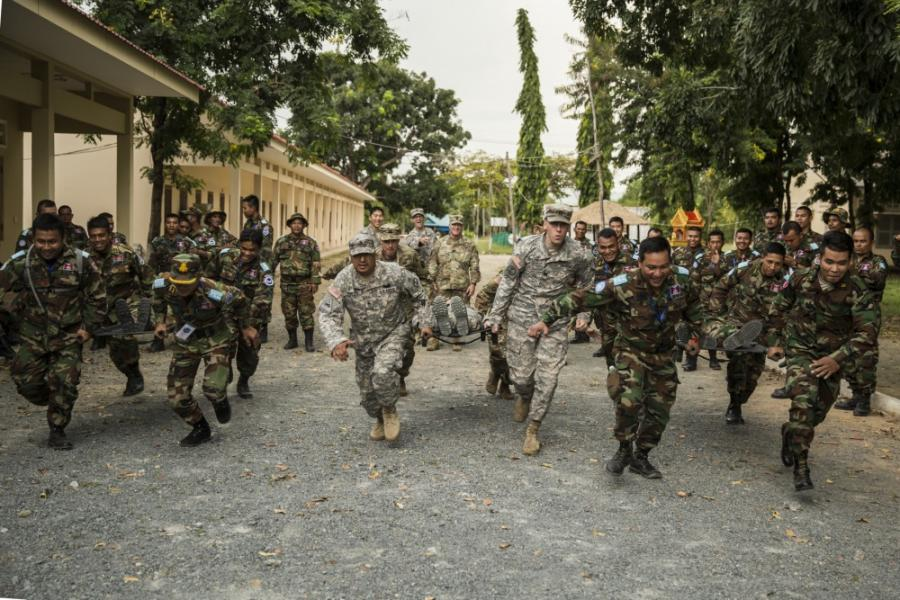 Members of the Idaho National Guard and the Royal Cambodian Armed Forces participate in a stretcher race