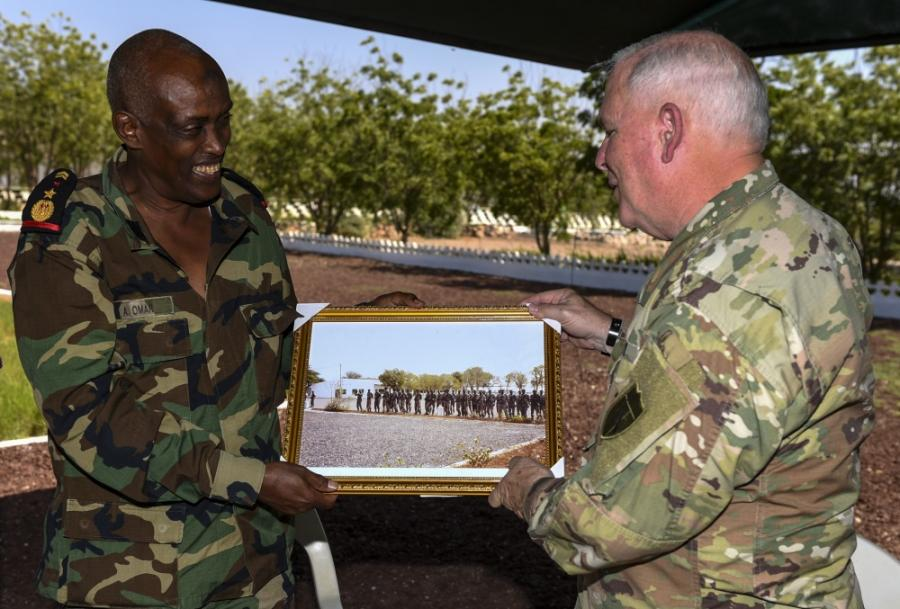 Djibouti Armed Forces (FAD) Lt. Col. A. Omar (left) presents a gift to U.S. Army National Guard Brig. Gen. Benjamin Adams III, Kentucky National Guard deputy adjutant general, during a State Partnership Program visit to the FAD military training center at Holhol, Djibouti.