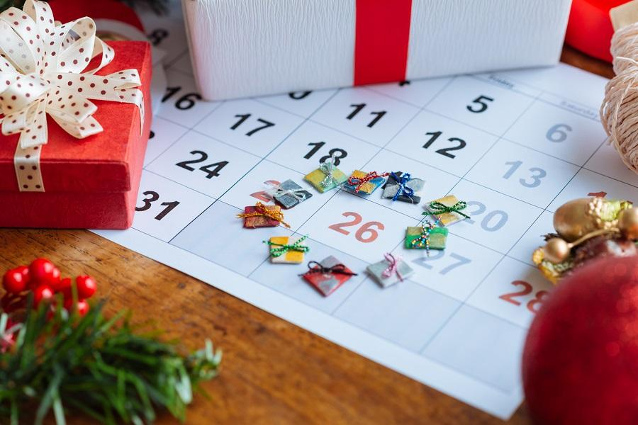 Photo of presents sitting on top of a calendar, with stickers surrounding December 26