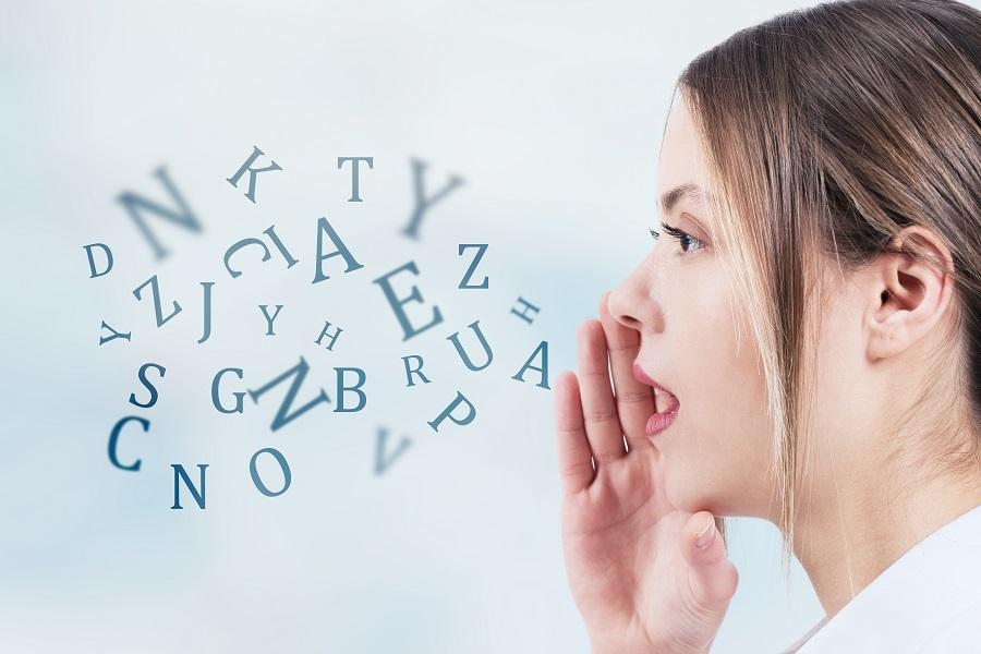 Image of woman speaking, with letters coming out of her mouth