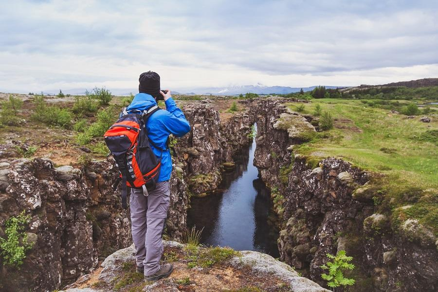Tourist taking picture at Thingvellir in Iceland