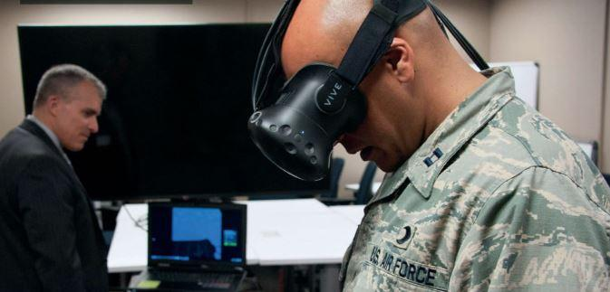 Soldier wearing virtual reality goggles