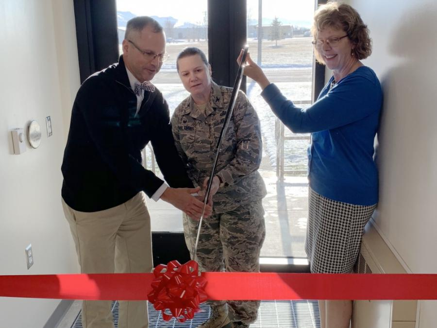 Members of the 373rd Intelligence, Surveillance and Reconnaissance Group cutting a ribbon at the Alaska Mission Operation Center Alaska Learning Center at Joint Base Elmendorf-Richardson, Alaska.