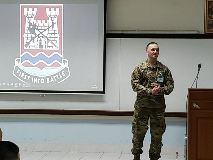 Maj. Mike Boitano stands in front of a presentation in Thailand