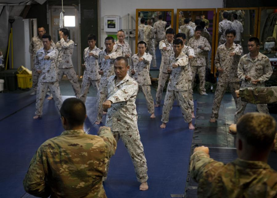 Japanese Ground Self-Defense Force Command Sgt. Maj. Kentaro Nakazato leads karate-style striking practice during a combatives exchange