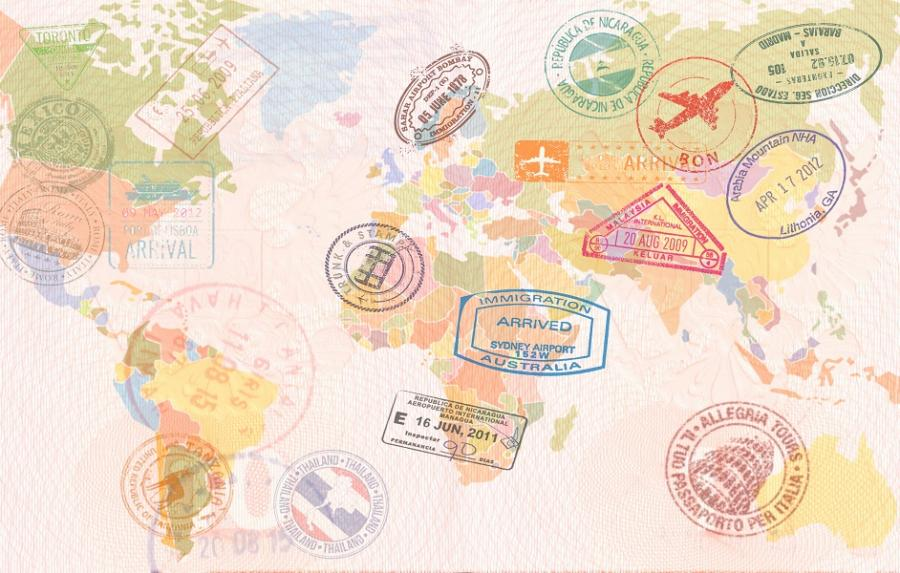 Colorful map of the world covered in passport stamps.
