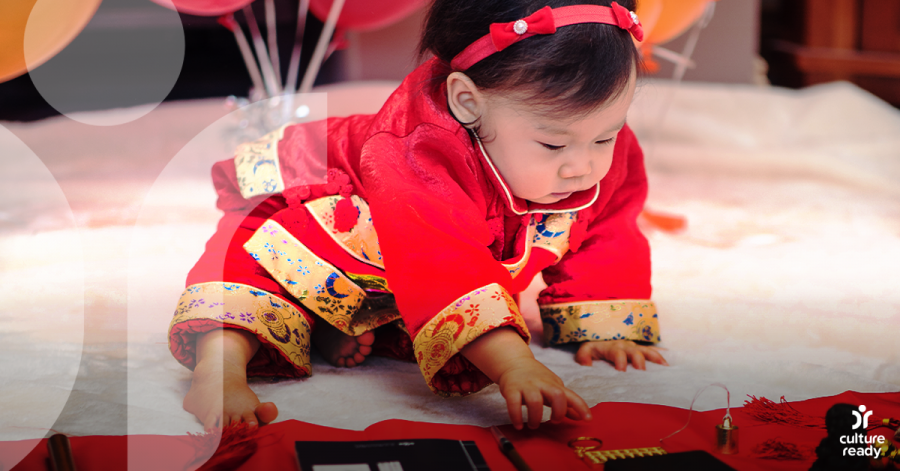 A baby girl dressed in red celebrating her second birthday