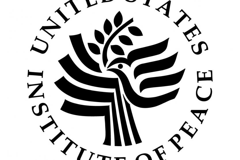 United States Institute of Peace Logo - swooping, artistic bird with olive branch, USIOP name circling the logo.
