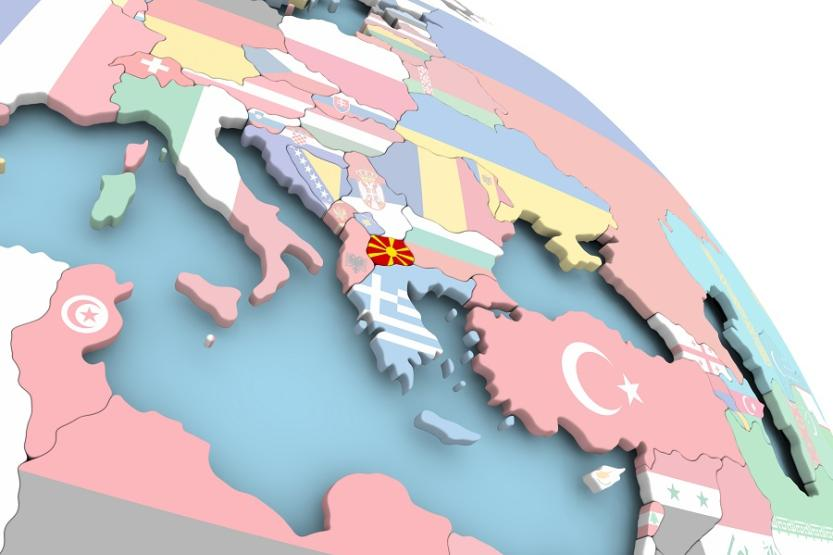 Rendering of globe, close-up over southern Europe. Each country is represented by its flag. The flag/country of Macedonia is brighter than the others.