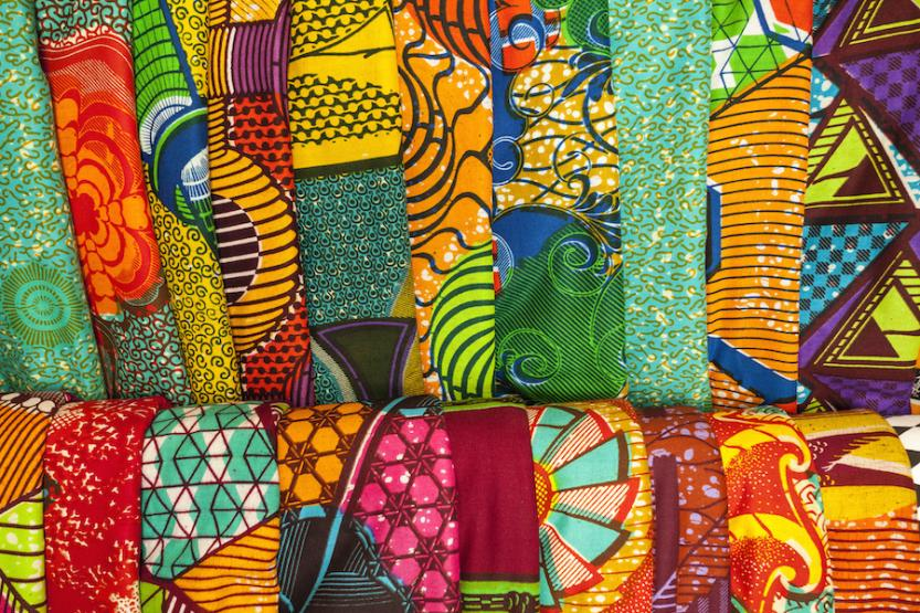A close of shot of multiple African traditional fabrics in a shop in Ghana, West Africa.
