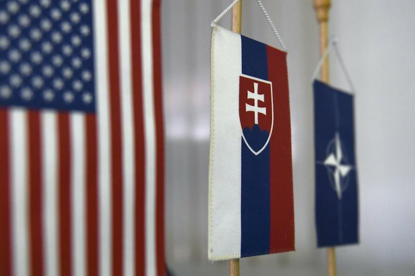 The U.S., Slovak, and NATO flags displayed together.