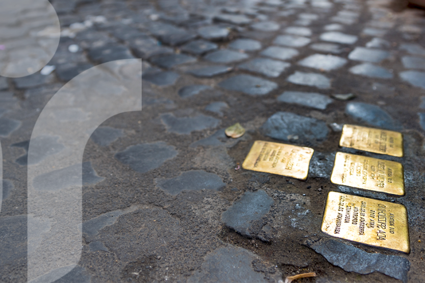 "Close up of golden Holocaust memorial ""stumbling stones"""
